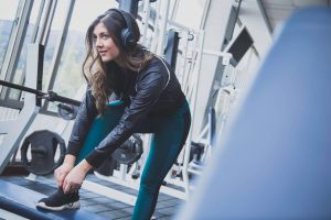 girl with headphones preparing for working